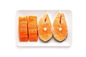 Fresh salmon and trout steaks photo