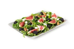 Figs, blackberries, arugula, mozzarella and walnuts salad. photo