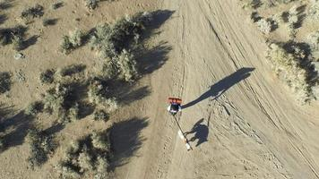 Aerial shot of a young man backpacking with his dog video