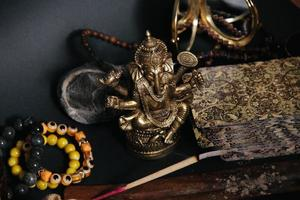 Table with occult attributes, top view. Ganesha figurine, photo