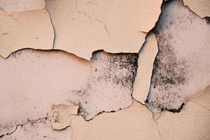 cracked peeling paint on old wall, closeup, background photo