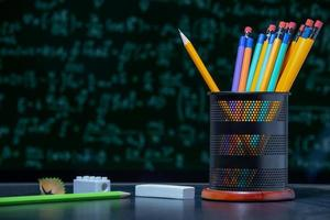 Back to school background with pencils in Pencil holder. photo