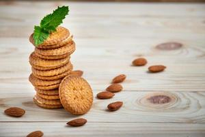 baked biscuits stuffed with milk cream and almond on wooden table photo