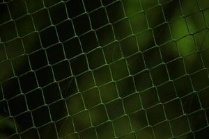 Hermoso fondo de una valla metálica en el jardín foto