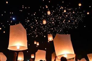 Floating lanterns on sky in Loy Krathong Festival photo