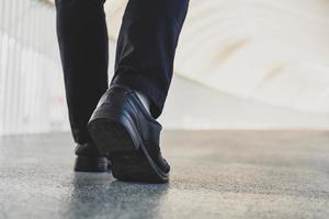 Businessman legs walking photo