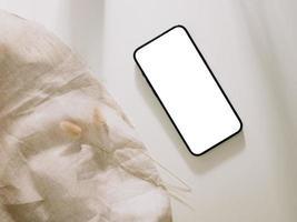 Smartphone mockup, Phone with blank screen template. Flat lay photo
