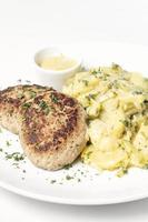 German frikadellen meatballs with creamy onion fried potatoes and mustard sauce on white plate photo