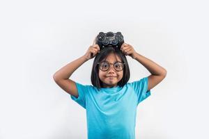 Portrait of little girl with joystick gamer. photo