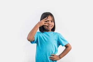Little girl feel angry in studio shot. photo