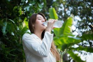 Beautiful business woman drinking water after hard work photo