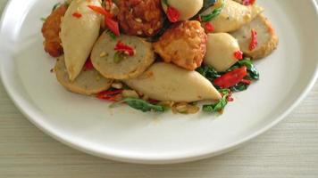 Stir fried spicy fish ball with basil and chili video
