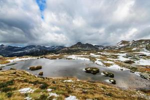 First autumn cold in the alpine lake photo