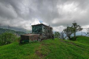 Hunting lodge with color camouflaged on the Italian Alps photo