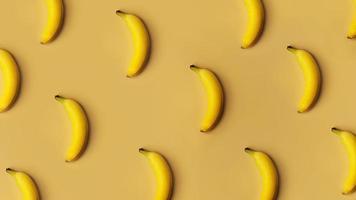 Fondo de plátanos en una fila sobre un fondo dorado foto