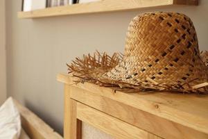 Straw hat on the shelf in room in a Scandinavian style photo