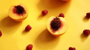 Raspberries and peaches for healthy summer eating photo