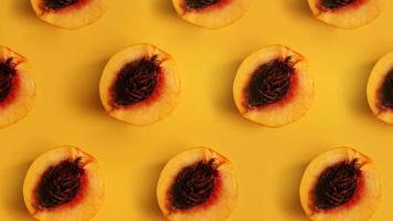 Ripe beautiful peaches with bones divided in half stacked in a row photo