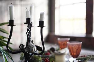 Forged metal candlestick with candles photo