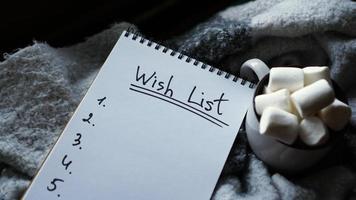 Christmas background with wish list, coffee mug with marshmallow photo