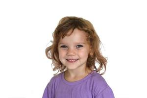 Portrait of a little curly girl on a white background isolated photo