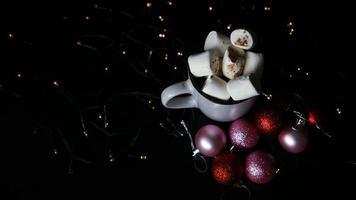 Mug of hot chocolate with marshmallow on a dark background photo