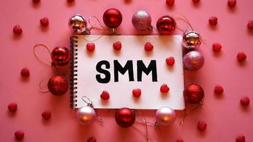 The inscription SMM in a notebook on a pink festive background photo