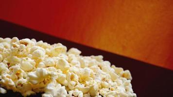 Heap of classic salty popcorn on black background photo