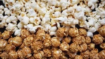 Assorted popcorn set. Sweet and salty popcorn on black background photo