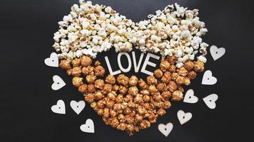 Love Cinema concept of popcorn arranged in a heart shape. photo