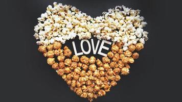 Love Cinema concept of popcorn arranged in a heart shape photo