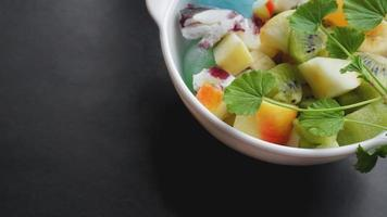 Close up desert with fresh fruit and ice cream photo