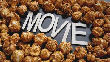 Golden caramel popcorn closeup. Background of popcorn photo