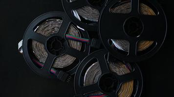 Coils of rgb led strip on a black table. Led strip photo