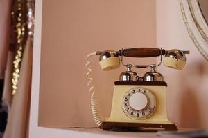 Old retro phone on the shelf photo