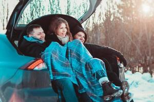 Enjoying road trip with best friends. Group of young cheerful people photo