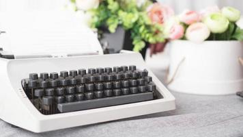 Vintage typewriter with paper. retro machine technology photo