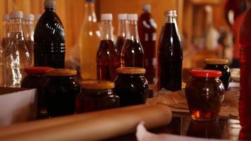 Homemade mead bottles on the shelf of an outdoor market. honey wine photo