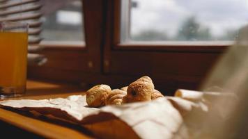 French breakfast with croissant, kraft crockery on kraft paper photo