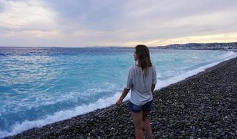NICE, FRANCE. Young woman enjoying the azure coast photo