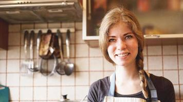 Portrait of beautiful woman at home in kitchen lifestyle photo