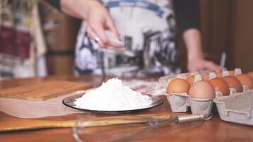 Close up scene of female hands making dough photo
