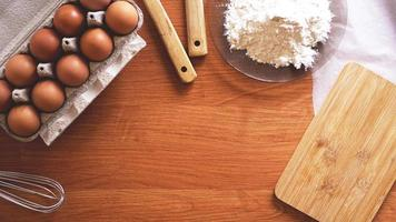 Ingredients and utensils for baking on a pastel background, top view. photo