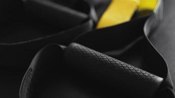 Training strap equipment on black background. Sport accessories photo