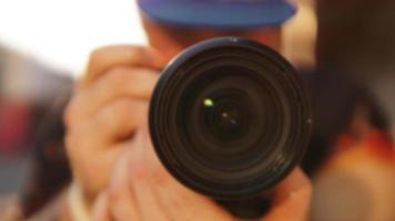 Blurred photo. Close-up of a man with a photographic lens photo