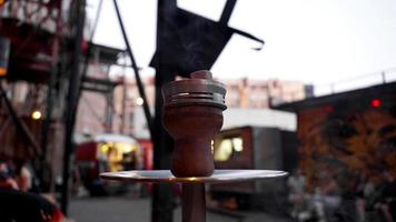 Close-up of a hookah bowl with charcoal. Hookah bar outside. photo