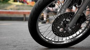 Motorcycle wheel close-up on a blurred background. Wheel on asphalt photo