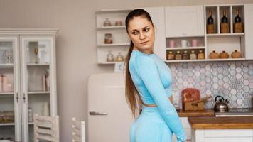 Beautiful woman in sports uniform photo