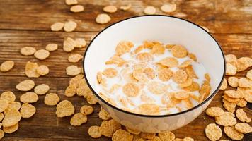 Eco healthy food background. Corn flakes with milk. Healthy food photo