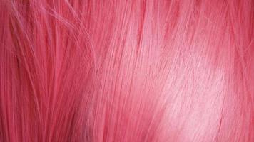 textura de primer plano de cabello rosado. puede usarse como fondo foto